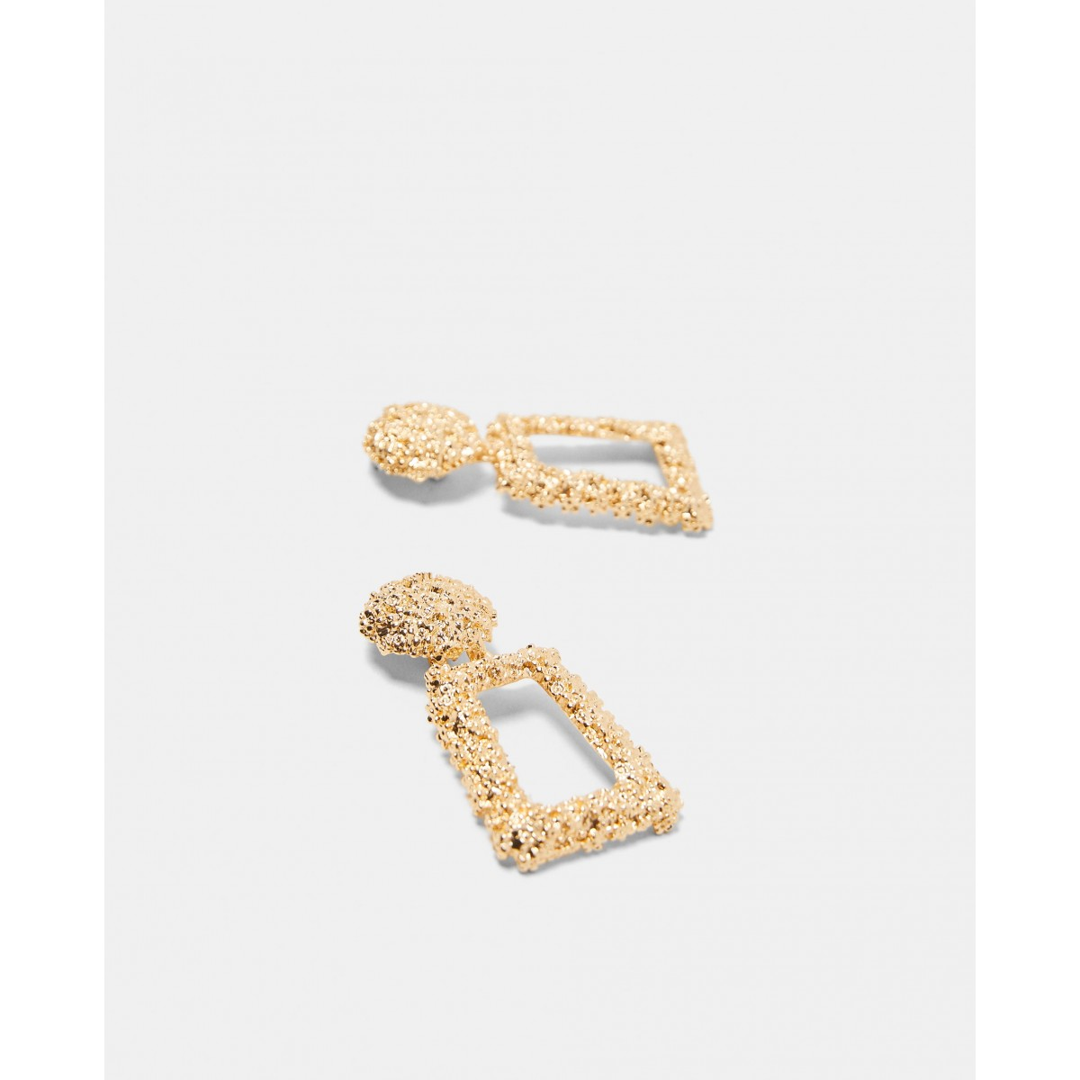 Zara Golden Raised Design Earrings
